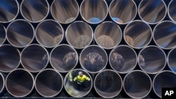 FILE - Tubes are stored in Sassnitz, Germany, to construct the natural gas pipeline Nord Stream 2 from Russia to Germany, Dec. 6, 2016.