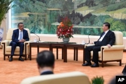 FILE - Tedros Adhanom, WHO director-general meets with Chinese President Xi Jinping before a meeting at the Great Hall of the People in Beijing, Jan. 28, 2020.