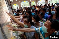 Filipino Catholics pray with protective masks on following confirmed cases of coronavirus in the country, at the National Shrine of Our Mother of Perpetual Help, Paranaque City, Metro Manila, Philippines, Feb. 5, 2020.