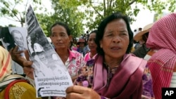 FILE - Farmers from some of provinces stage a protest rally near prime minister's residence in Phnom Penh, Cambodia, July 22, 2019.