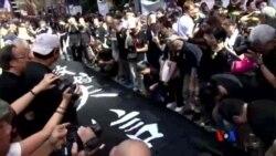 2014-09-14 美國之音視頻新聞: 和平佔中發起黑布大遊行抗議假普選