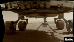 NASA's Ingenuity helicopter can be seen here with all four of its legs deployed before dropping from the belly of the Perseverance rover on March 30, 2021, the 39th Martian day, or sol, of the mission. (Credit: NASA/JPL-Caltech/MSSS)