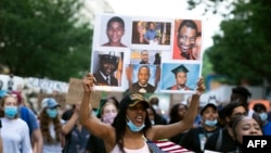 Demonstrators march near the White House, to protest police brutality and racism, on June 10, 2020 in Washington, DC. - Demonstrations are being held across the US following the death of George Floyd on May 25, 2020, while being arrested in…