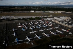 FILE PHOTO: Boeing 737 Max aircraft are parked in a parking lot at Boeing Field in this aerial photo taken over Seattle
