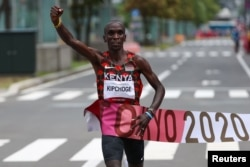FILE - Eliud Kipchoge of Kenya crosses the finish line to win gold in the men's marathon at the Tokyo 2022 Olympics, in Sapporo, Japan, August 8, 2021.