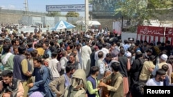 People try to get into Hamid Karzai International Airport in Kabul, Afghanistan, Aug. 16, 2021.