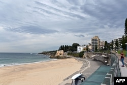FILE - This general view shows an empty Coogee beach in Sydney on April 16, 2020.