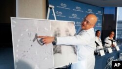 Dr. Hassan Nemeh, Surgical Director of Thoracic Organ Transplant, shows areas of a patient's lungs during a news conference at Henry Ford Hospital in Detroit, Nov. 12, 2019.