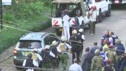 Armed Guards Walk Toward Nairobi Hotel
