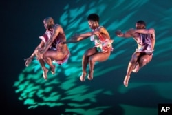 """FILE - Performers with Alvin Ailey American Dance Theater rehearse """"Divining"""" by choreographer Judith Jamison, Thursday, Dec. 5, 2019 in New York."""