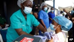 Hospital staff receives one of the country's first coronavirus vaccinations using AstraZeneca vaccine manufactured by the Serum Institute of India and provided through the global COVAX initiative, at Yaba Mainland hospital in Lagos, March 12, 2021.