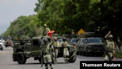 """Members of the National Guard are seen at a military check point after Mexican security forces captured Jose Antonio Yepez known as """"El Marro"""" (The Mallet) in Santa Cruz de Juventino Rosas, Aug. 2, 2020."""