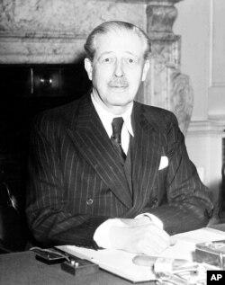 FILE - Britain's new Prime Minister Harold MacMillan at his desk at 10 Downing Street, London, Jan. 11, 1957.