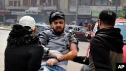 عکسی از برخورد با معترضان در شهر طرابلس در شمال لبنان