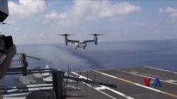美防长在南中国海视察航母