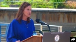 Gretchen Whitmer unveils a proposal to spend about $1 billion in federal pandemic rescue funding to boost the business climate on Monday, Aug. 23, 2021, at Rotary Park along the Grand River in Lansing, Mich. It is part of a broader $2.1 billion…