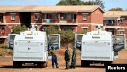 FILE - Police patrol during a 21-day nationwide lockdown called to help curb the spread of coronavirus disease, in Harare, Zimbabwe, April 3, 2020.