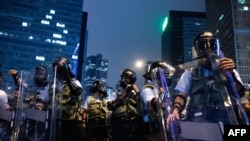 Riot police stand guard after a protest against a controversial extradition law proposal in Hong Kong on June 12, 2019.