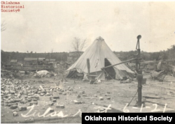 Residents of the Greenwood district of Tulsa, Oklahoma, living in tents after White mob violence destroyed the once-thriving African American area. (Ella Mahler Collection, OHS).