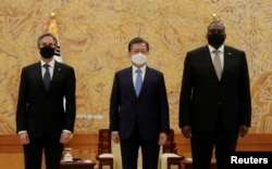 FILE - South Korean President Moon Jae-in poses for a photo with U.S. Secretary of State Antony Blinken and U.S. Defense Secretary Lloyd Austin during their meeting at the presidential Blue House in Seoul, South Korea, March 18, 2021.