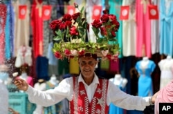 A flower seller is pictured at the old market in Tunis, Tunisia, July 30, 2021.