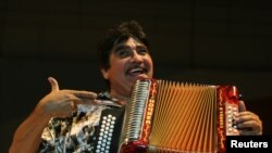 FILE - Mexican musician Celso Pina performs during the Santa Lucia International Festival in Monterrey, northern Mexico, Sept. 21, 2008.