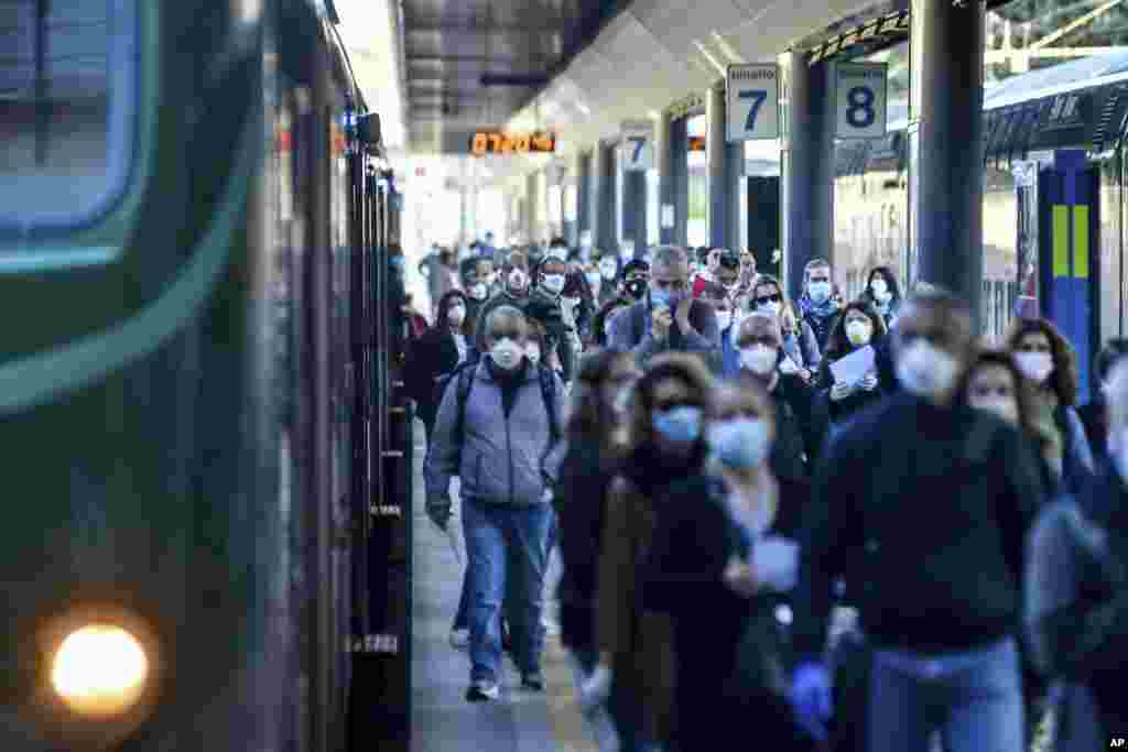 Commuters crowd Cadorna train station in Milan, Italy. Italians returned to work and restrictions on movement eased after a two-month coronavirus shutdown.