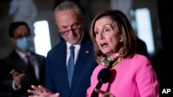 House Speaker Nancy Pelosi, accompanied by Senate Minority Leader Sen. Chuck Schumer, left, speak to reporters following a meeting with Treasury Secretary Steven Mnuchin and White House Chief of Staff Mark Meadows, Aug. 7, 2020.