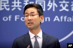 FILE - In a still image from video, Chinese Foreign Ministry spokesman Geng Shuang speaks during a media briefing in which he commented on investigations into Chinese-Australian writer Yang Hengjun in Beijing, July 17, 2019.