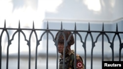 A Myanmar soldier looks on as he stands inside city hall after soldiers occupied the building, in Yangon, Myanmar, Feb. 2, 2021.