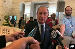 FILE - Former New York City Mayor Michael Bloomberg talks to the media after filing paperwork to appear on the ballot in Arkansas' March 3 presidential primary, Nov. 12, 2019 in Little Rock, Ark.