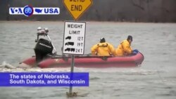 VOA60 America - Nebraska, South Dakota, and Wisconsin have declared national emergencies due to record breaking flooding