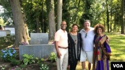 Reporter Chris Simkins, second from right, meets with members of the Tucker family at the first African cemetery in colonial America, in Hampton, Virginia.
