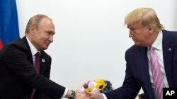 美國總統特朗普(右)與俄羅斯總統普京(左)。(資料圖片)