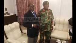 Zimbabwe President Shakes Hands with General Behind State Capture