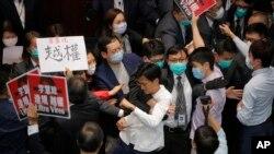 Pan-democratic legislators scuffle with security guards and pro-China legislators at the Legislative Council's House Committee meeting in Hong Kong, May 8, 2020.