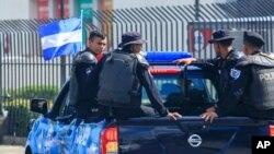 FILE - A Nicaraguan National Police pickup truck patrols in downtown Managua, Nicaragua, Aug. 24, 2019.