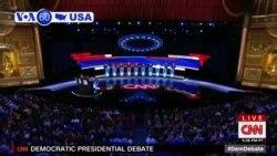 VOA60 America - Former US VP Joe Biden Clashes with Democratic Presidential Rivals