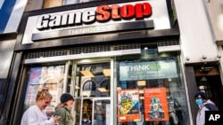 FILE - Pedestrians pass a GameStop store on 14th Street at Union Square, Jan. 28, 2021, in the Manhattan borough of New York.