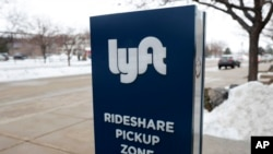 FILE - A sign for the ride-sharing service Lyft is pictured. Lyft Inc. was one of several companies on Sept. 3, 2021, that criticized new Texas laws on abortion, handgunsand voting limitations.