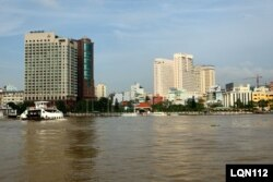Ho Chi Minh City, shown in 2009, is the business hub of Vietnam, which aims to cut emissions by requiring businesses to submit pollution data to the government.