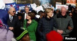 Seven of the Democratic US Presidential candidates including former U.S. Vice President Joe Biden, Sen. Amy Klobuchar, Sen. Elizabeth Warren and Sen. Bernie Sanders, walk arm-in-arm with local African-American leaders during the Martin Luther King…
