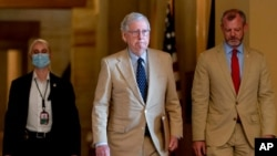 FILE - Senate Minority Leader Mitch McConnell of Kentucky walks toward the Senate chamber in Washington, Aug. 9, 2021.