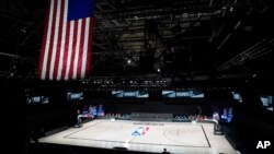 The court sits empty after a postponed NBA basketball playoff game between the Milwaukee Bucks and the Orlando Magic, Aug. 26, 2020, in Lake Buena Vista, Fla.