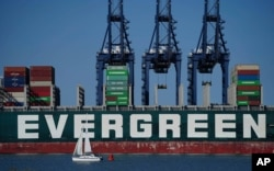 FILE - A view of the container ship Ever Given, chartered and operated by container transportation and shipping company Evergreen Marine, at the Port of Felixstowe in Suffolk, England, Aug. 3, 2021.