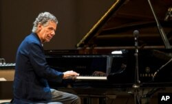 FILE - Chick Corea performs with Eddie Gomez and Brian Blade in Moscow, Russia, May 15, 2017.