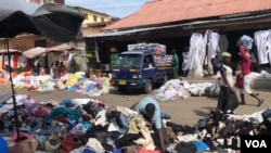 Piles of clothing and fabric can be found throughout Kantamanto market, many imported from Western countries, in Accra, Ghana, Sept. 22, 2020. (Stacey Knott/VOA)