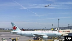An Air Canada plane sits on the tarmac at Trudeau airport near Montreal, Canada.