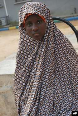 FILE - This Dec. 24, 2014, photo shows Zahra'u Babangida, a 13 -year-old girl arrested with explosives strapped to her body, in Kano, Nigeria.