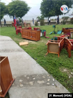FILE - Furniture litters the ground after being dragged out of the Haitian Senate by opposition senators, May 30, 2019.